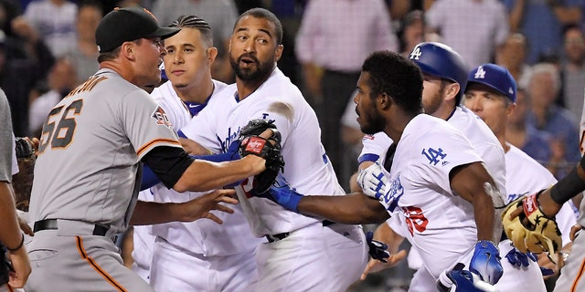 Dodgers and Giants players get in the middle of Puig and Hundley.