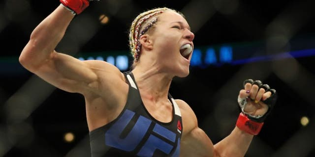 July 23, 2016; Chicago, IL, USA; Felice Herrig (red gloves) celebrates after defeating Kailin Curran (blue gloves) during UFC Fight Night at United Center. Mandatory Credit: Kamil Krzaczynski-USA TODAY Sports
