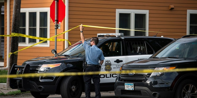 Police in Minneapolis say officers shot and killed a man who was firing a handgun as he walked down a city street.