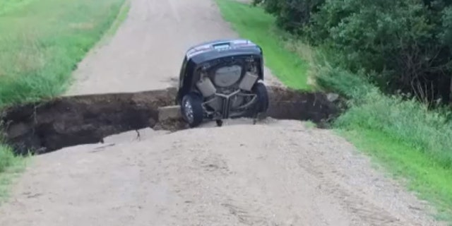 A Minnesota teen survived driving into a sinkhole.