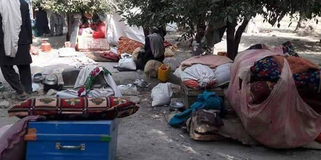Displaced Afghans, forced out by ISIS fighting.