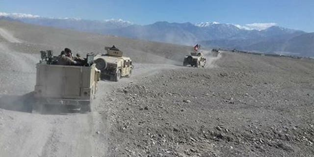 Afghan forces near the MOAB site.