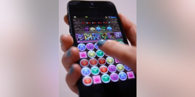 File photo: A iPhone demonstration of GungHo Online Entertainment Inc's mobile online game Puzzle and Dragons is pictured at the company's offices in Tokyo April 10, 2013. (REUTERS/Yuya Shino)