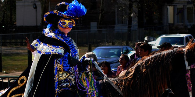 One of the 1.3 million people take part in Mobile's Carnival festivities.