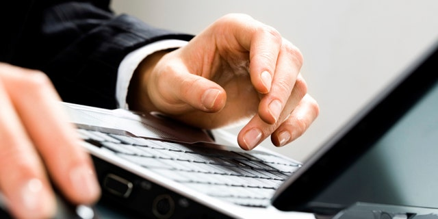 Image of human hands doing some computer work