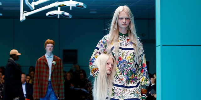 Designer Alessandro Michele sent models down the catwalk toting decapitated mannequin heads, designed to look just like the models' own