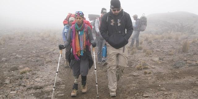 Mona Patel leading the crew with Justin Pfaff during their Mt. Kilimanjaro climb.