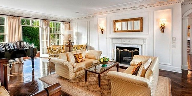 This principal room features one of the home's eight fireplaces.
