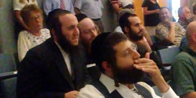 Residents of the Hasidic village of Kiryas Joel at a hearing in Orange County, New York about a plan to let them annex land from the town of Monroe and form their own town