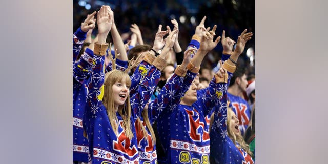 Kansas fans set a world record for largest gathering of people wearing holiday sweaters.