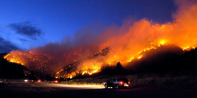 Aug. 22: Flames light up the evening sky near Missoula, Mont., as a wildfire burns through timber.