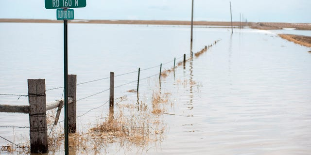 A pasture lays submerged under five to 15 feet of water at the Gildford Colony north of Gildford, Mont