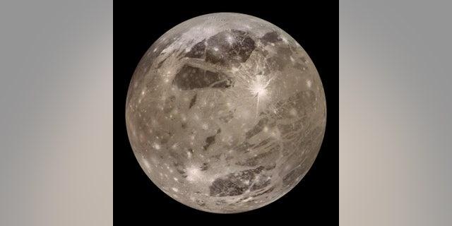 One of Jupiter's moons, Ganymede, is seen above.