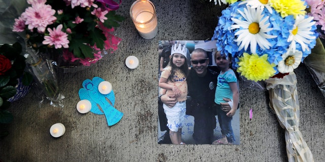 A photo of Moreno at a memorial outside the Kent Police Station.