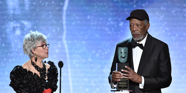 Rita Moreno, left, looks on as Morgan Freeman accepts the Life Achievement Award at the 24th annual Screen Actors Guild Awards at the Shrine Auditorium & Expo Hall on Sunday, Jan. 21, 2018, in Los Angeles. (Photo by Vince Bucci/Invision/AP)