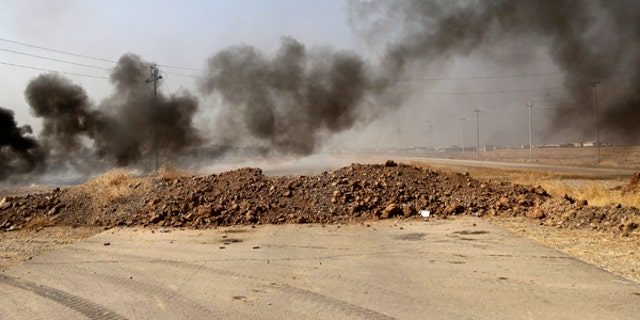 Smoke rises from Islamic state positions after an airstrike by coalition forces in villages surrounding Mosul.