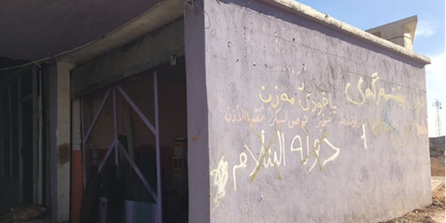 Homes that ISIS fighters occupied until just weeks ago are strewn with trash and emblazoned with graffiti.