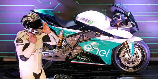 Former MotoGP rider Loris Caprirossi unveils MotoE's Energica Ego racing bike.