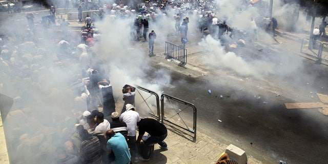 An escalating dispute over metal detectors at a contested Jerusalem shrine turned violent on Friday, setting off widespread clashes between Palestinian stone-throwers and Israeli troops.