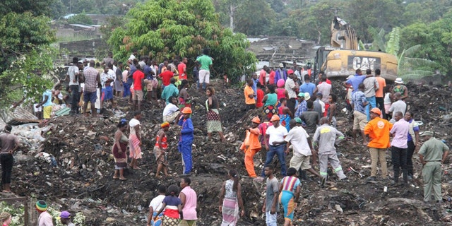 Rescuers search for survivors at the collapse of a garbage mound in Maputo, Mozambique.