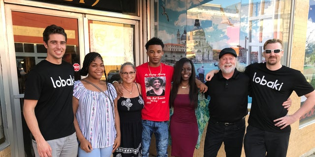 Members of the Lobaki Inc. team pose for a photo outside their office in downtown Clarksdale, Miss. (Left to right) Michael Bezzina, Mya Calhoun, Wendy Farley, Deuntay Williams, Shalin Jewett, Vince Jordan and Vinny Jordan.