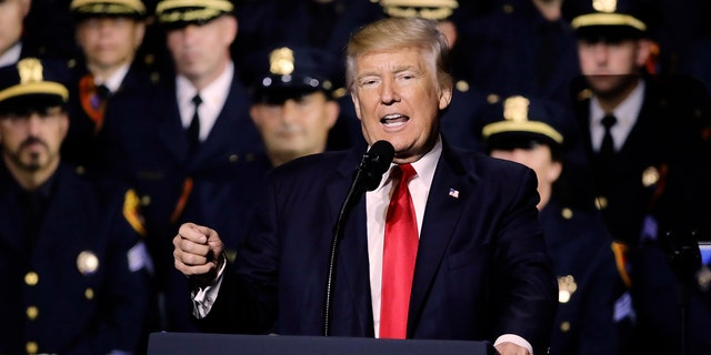 President Donald Trump speaks to law enforcement officials on the street gang MS-13, Friday, July 28, 2017, in Brentwood, N.Y. (AP Photo/Frank Franklin II)