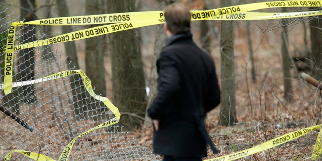 Police tape is seen in a wooded area in Long Island, New York where remains were discovered. It is believed that the victims were killed by MS-13 gang members.