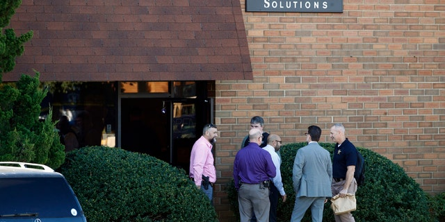 Officials stand outside the scene of a fatal shooting at a business park in the Edgewood area of Harford County, Md., Wednesday, Oct. 18, 2017.