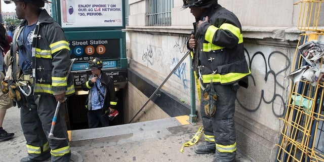 New York City emergency personnel work at the scene of the subway derailment on Tuesday, June 27, 2017.