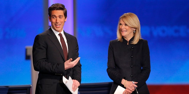 Debate moderators ABC News anchor David Muir and correspondent Martha Raddatz talk to the audience before the start of the Democratic presidential candidates debate at St. Anselm College in Manchester, New Hampshire December 19, 2015.