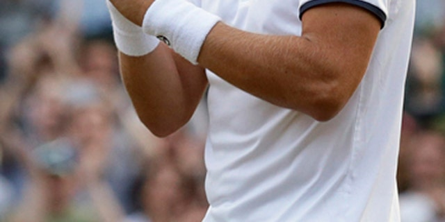 Gilles Muller celebrates after beating Rafael Nadal in the Round of 16 at Wimbledon Monday.