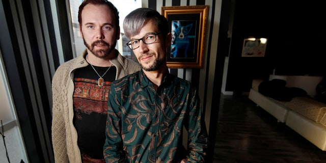 In this Nov. 28, 2017, photo, Charlie Craig and David Mullins are shown in their home in Denver.