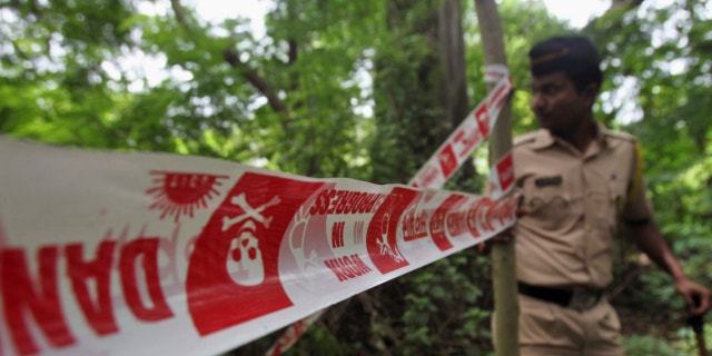 Aug. 23, 2013: An Indian policeman inspects the site where a 22-year-old woman was gang raped in Mahalaxmi area in Mumbai India.