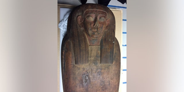 A 2,500-year old coffin that may contain a mummy lies at the University of Sydney in Sydney, Australia March 27, 2018.