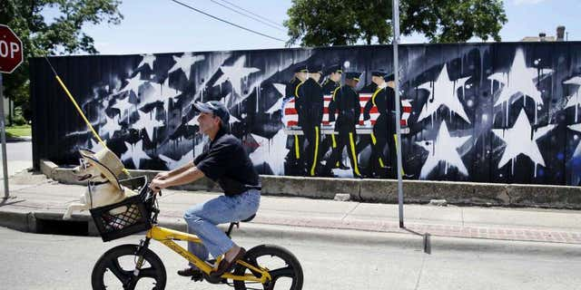 Mural on property of Last Call Lounge in Dallas, paying tribute to fallen officers on one-year anniversary of the ambush on them.