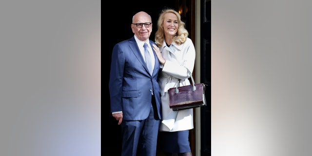 News Corp Executive Chairman Rupert Murdoch and Jerry Hall leave Spencer House, London, after getting married, Friday March 4, 2016. (Yui Mok/PA via AP) UNITED KINGDOM OUT NO SALES NO ARCHIVE