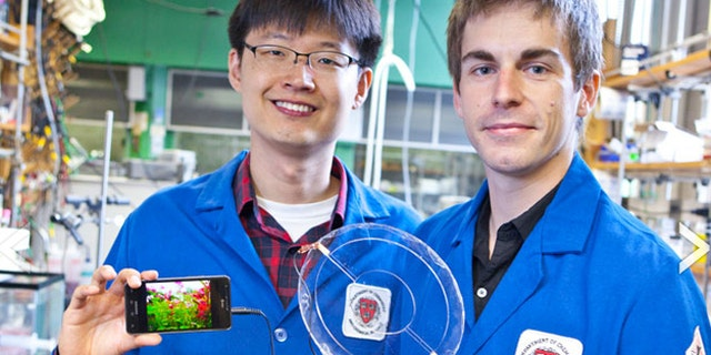 Jeong-Yun Sun (left) and Christoph Keplinger (right) demonstrate their transparent ionic speaker.