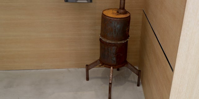 A meat smoker is displayed at the Museum of Broken Relationships.