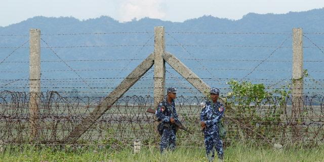 Burmese border guard police patrol near the Burma-Bangladeshi border outside Maungdaw, northern Rakhine state, November 12, 2017