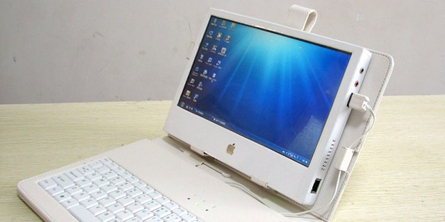 """Liu Xinying's """"DIY IPAD 3"""" touchscreen tablet computer, shown with a case, keyboard and mouse."""