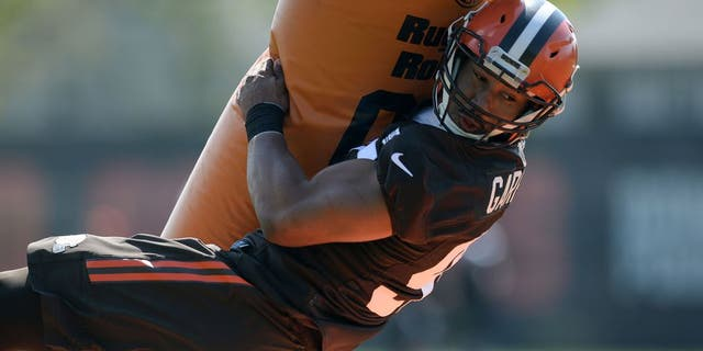 Defensive end Myles Garrett #95 of the Cleveland Browns takes part in a tackling drill during a rookie mini camp practice on May 13, 2017 at the Cleveland Browns training facility in Berea, Ohio.