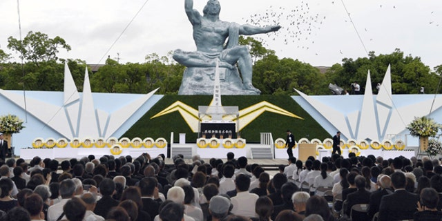 Doves fly over the Statue of Peace at Nagasaki Peace Park in Nagasaki, southern Japan, during a ceremony to mark the 72nd anniversary of the world's second atomic bomb attack, Aug. 9, 2017.
