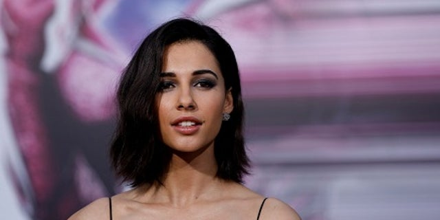 """Cast member Naomi Scott poses at the premiere of """"Power Rangers"""" in Los Angeles, California U.S., March 22, 2017.   REUTERS/Mario Anzuoni - RC114DF37160"""