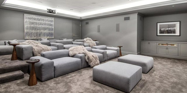 The home features its own screening room in addition to a gym and wine cellar.