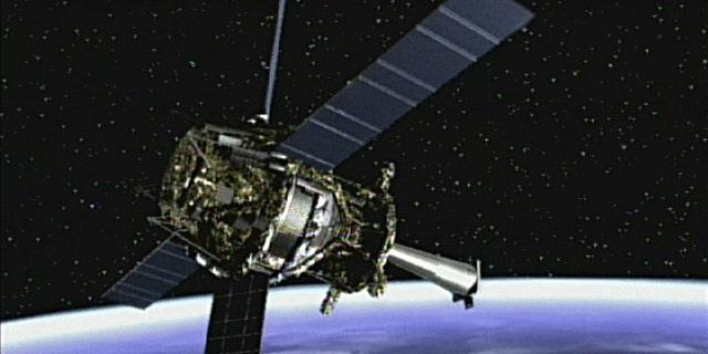 Artist's concept of Gravity Probe B spacecraft in orbit around the Earth.