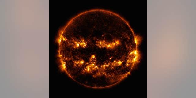 The NASA image of the Sun resembling a jack-o-lantern (Credit: NASA/SDO)