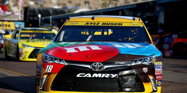 AVONDALE, AZ - NOVEMBER 12: Kyle Busch, driver of the #18 M&M's Toyota, drives through the garage area during practice for the NASCAR Sprint Cup Series Can-Am 500 at Phoenix International Raceway on November 12, 2016 in Avondale, Arizona. (Photo by Sarah Crabill/Getty Images)
