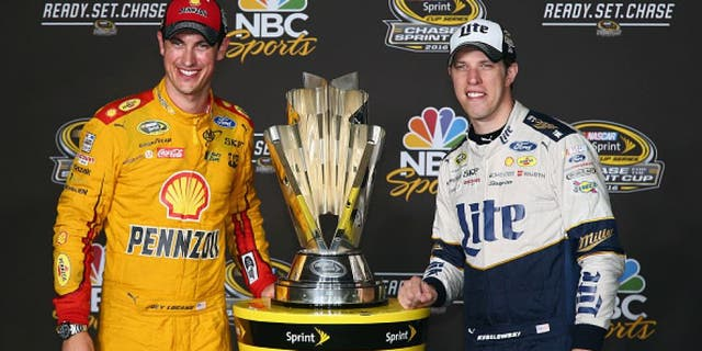 RICHMOND, VA - SEPTEMBER 10: Brad Keselowski, driver of the #2 Miller Lite Ford, and Joey Logano, driver of the #22 Shell Pennzoil Ford, pose with the NASCAR Sprint Cup trophy after the NASCAR Sprint Cup Series Federated Auto Parts 400 at Richmond International Raceway on September 10, 2016 in Richmond, Virginia. (Photo by Sarah Crabill/Getty Images)