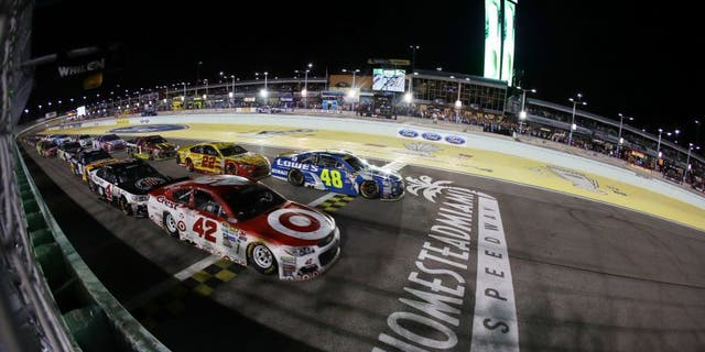 HOMESTEAD, FL - NOVEMBER 20: Kyle Larson, driver of the #42 Target Chevrolet, and Jimmie Johnson, driver of the #48 Lowe's Chevrolet, lead the field on the final restart during the NASCAR Sprint Cup Series Ford EcoBoost 400 at Homestead-Miami Speedway on November 20, 2016 in Homestead, Florida. (Photo by Sarah Crabill/Getty Images)