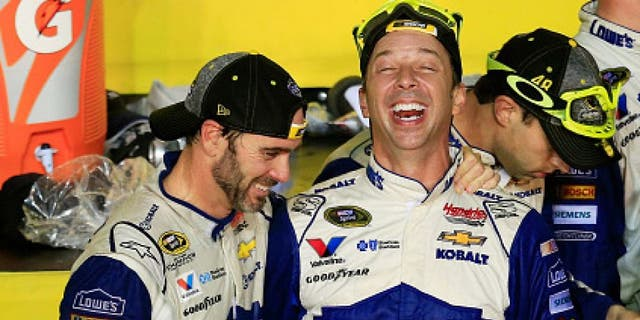 HOMESTEAD, FL - NOVEMBER 20: Jimmie Johnson (L), driver of the #48 Lowe's Chevrolet, celebrates with crew chief Chad Knaus in Victory Lane after winning the NASCAR Sprint Cup Series Ford EcoBoost 400 and the 2016 NASCAR Sprint Cup Series Championship at Homestead-Miami Speedway on November 20, 2016 in Homestead, Florida. Johnson wins a record-tying 7th NASCAR title. (Photo by Chris Trotman/Getty Images)